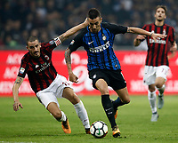 Calcio, Serie A: Milano, stadio Giuseppe Meazza, 15 ottobre 2017.<br /> Inter's Matias Vecino (r) in action with Milan's Leonardo Bonucci (l) during the Italian Serie A football match between Inter and Milan at Giuseppe Meazza (San Siro) stadium, October15, 2017.<br /> UPDATE IMAGES PRESS/Isabella Bonotto