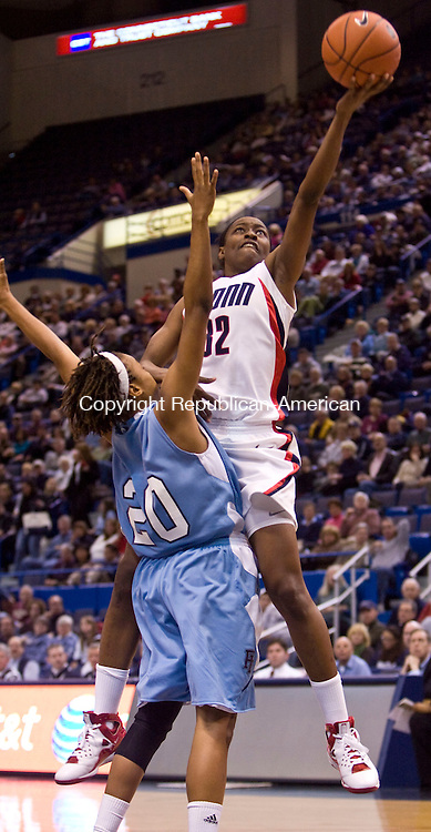 HARTFORD, CT - 22 NOVEMBER 2008 -112208JT06-<br /> UConn's Kalana Greene jumps over Rhode Island's Janae Miller to make a layup, which she missed, during Saturday's game at the XL Center in Hartford. The Huskies won, 91-43.<br /> Josalee Thrift / Republican-American