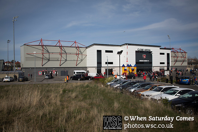Morecambe 0 Plymouth Argyle 2, 25/03/2016. Globe Arena, League 2. Fans arriving at the Globe Arena before Morecambe hosted Plymouth Argyle in a League 2 fixture. The stadium was opened in 2010 and replaced Morecambe's traditional home of Christie Park which had been their home since 1921, the year after their foundation. Plymouth won this fixture by 2-0 watched by 2,081 spectators, in a game delayed by 30 minutes due to traffic congestion affecting travelling Argyle fans.  Photo by Colin McPherson.