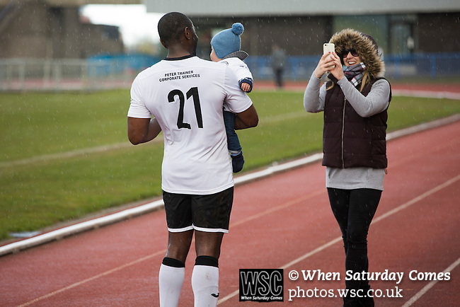 Edinburgh City 1 Cove Rangers 1, 30/04/2016. Commonwealth Stadium, Scottish League Pyramid Play Off. Home defender Joe Mbu posing for a family photograph after the final whistle in the Scottish pyramid play-off second leg between Edinburgh City (in white) and Cove Rangers at the Commonwealth Stadium at Meadowbank in Edinburgh. The match between the champions of the Lowland and Highland Leagues determined which club would play-off against East Stirlingshire for a place in the Scottish league. The second leg ended 1-1, giving Edinburgh City a 4-1 aggregate win. Photo by Colin McPherson.