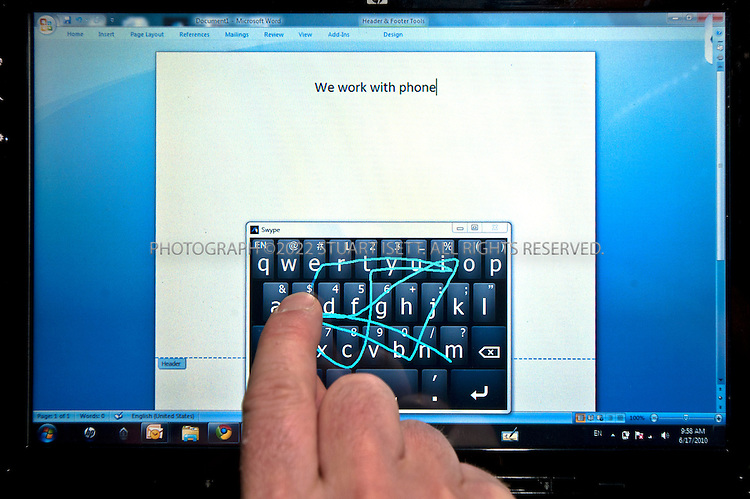 6/17/2010--Seattle, WA, USA..Cliff Kushler, the original inventor of predictive texting technology, has created a new method of inputting text on a touchscreen by dragging a finger across a touch keyboard called Swype. He hopes it will become the default way to type on a touchscreen. By the end of this year, 10 million devices on all four US carriers are slated to have the Swype technology and the company is expanding to Asia, Europe and South America. ..©2010 Stuart Isett. All rights reserved.