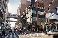 Stores and shopping in Downtown Brooklyn in New York on Friday, January, 17, 2014. The area has been for years a middle and lower economic shopping strip but because of increased development in the area, notably hi-rise luxury apartment buildings, chain stores and high-end retailers are moving in. Rents are rising and the smaller mom and pop stores, as well as regional chains are being forced out.  (© Richard B. Levine)