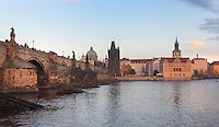 The Charles Bridge or Karluv most, built 1357 - 15th century, looking towards the Old Town bridge tower and the Bedrich Smetana Museum, seen from the bank of the Vltava river in Prague, Czech Republic. Its construction began under King Charles IV, replacing the old Judith Bridge built 1158'??1172 after flood damage in 1342. This new bridge was originally called the Stone Bridge (Kamenny most) or the Prague Bridge (Prazsky most) but has been the Charles Bridge since 1870. The bridge is 621m long and nearly 10m wide, resting on 16 arches shielded by ice guards, seen here. It is protected by three bridge towers, two on the Lesser Quarter side and one on the Old Town side. The historic centre of Prague was declared a UNESCO World Heritage Site in 1992. Picture by Manuel Cohen