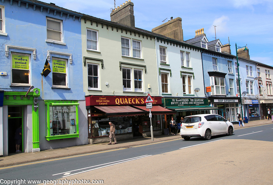 Row of shops in town centre of Porthmadog, Gwynedd, north west Wales, UK