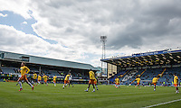 The Wycombe players warm up during the Sky Bet League 2 match between Portsmouth and Wycombe Wanderers at Fratton Park, Portsmouth, England on 23 April 2016. Photo by Andy Rowland.