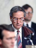 United States Senator George Mitchell (Democrat of Maine) listens to the closing remarks during the Joint US House and Senate Iran-Contra Committee hearings on Capitol Hill in Washington, DC on August 3, 1987.<br />