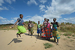 Children skip rope in Kaluhoro, Malawi. With support from the Ekwendeni Hospital AIDS Program, villagers here participate in a Building Sustainable Livelihoods program, working together to earn and save money, raise more nutritious food, and receive vocational training.