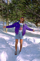 Adult age 40 wearing shorts in snow on skiing vacation. Bessemer Ironwood Michigan USA Big Powderhorn