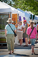 Shoppers of all ages strolled Park Street sampling Italian Ices and other snacks, while browsing through booths and tents filled with jewelry, sculptures, paintings and more during the final weekend of this season's Art in the Park, hosted by the Naples Art Association at The von Liebig Art Center, Naples, Florida, USA, April 2, 2011. Photo by Debi Pittman Wilkey