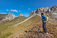 Hiker at Snowden mountain, Brooks Range mountains, Arctic, Alaska.