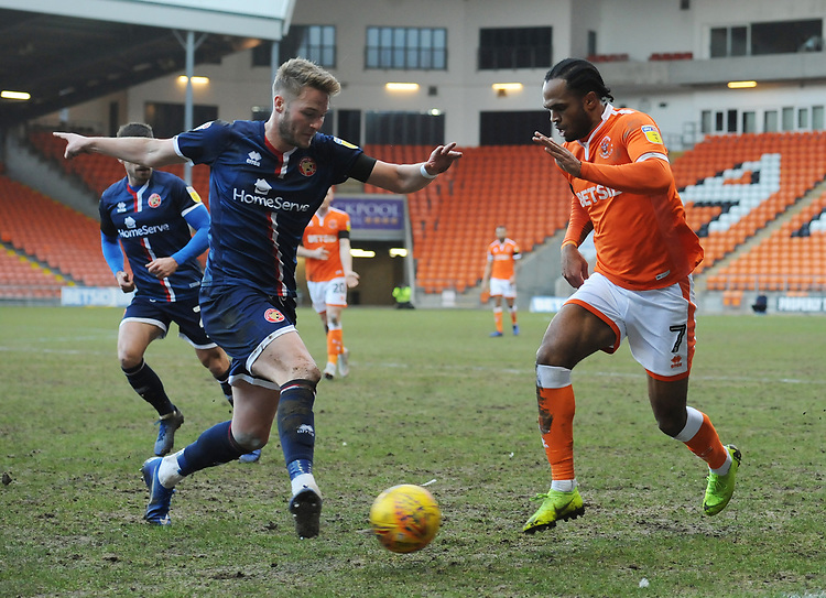 Blackpool's Nathan Delfouneso under pressure from Walsall's Cameron Norman<br /> <br /> Photographer Kevin Barnes/CameraSport<br /> <br /> The EFL Sky Bet League One - Blackpool v Walsall - Saturday 9th February 2019 - Bloomfield Road - Blackpool<br /> <br /> World Copyright &copy; 2019 CameraSport. All rights reserved. 43 Linden Ave. Countesthorpe. Leicester. England. LE8 5PG - Tel: +44 (0) 116 277 4147 - admin@camerasport.com - www.camerasport.com