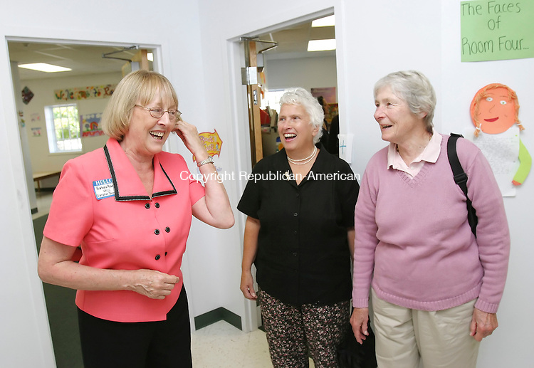 WINSTED,  CT 24 September 2005 -092405BZ01- Barbara Adams, executive director of the Winsted Area Child Care Center, left, jokes that she has a few gray hairs, with Ayreslea Denny (CQ), of Norfolk, and Penny Putnam, of Colebrook, at the grand opening of the center's long awaited new building on Lake Street Saturday monring.  Denny and Putnam were two of the original founders of the Winsted Area Child Care Center in 1980.  Putnam was also the original director of the center.<br /> Jamison C. Bazinet / Republican-American