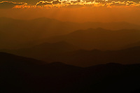 Sun rays and orange sky at sunset viewed from Clingman's Dome in the Great Smoky Mountains National Park