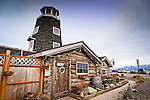 The exterior of historic cabin, Salty Dawg Saloon on Homer Spit, Homer, Southcentral Alaska, Spring.
