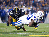 Frank Gore #23 of the Indianapolis Colts dives in for a touchdown past Lawrence Timmons #94 of the Pittsburgh Steelers in the first half during the game at Heinz Field on December 6, 2015 in Pittsburgh, Pennsylvania. (Photo by Jared Wickerham/DKPittsburghSports)