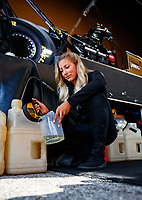 Sep 2, 2017; Clermont, IN, USA; NHRA top fuel driver Leah Pritchett mixes fuel in her pit area during qualifying for the US Nationals at Lucas Oil Raceway. Mandatory Credit: Mark J. Rebilas-USA TODAY Sports