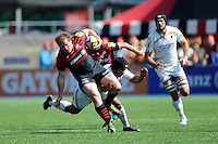 Rhys Gill of Saracens evades the tackle of Mariano Galarza of Worcester Warriors during the Aviva Premiership match between Saracens and Worcester Warriors at Allianz Park on Saturday 3rd May 2014 (Photo by Rob Munro)