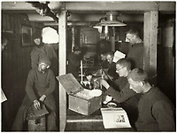 BNPS.co.uk (01202 558833)<br /> Pic: Bonhams/BNPS<br /> <br /> 'The Ritz' - the crew sheltered over winter 1915 in the trapped hull of Endurance.<br /> <br /> Photographic record of one of the worlds most epic tales of endurance.<br /> <br /> Remarkable photos documenting Sir Ernest Shackleton's ill-fated attempt to cross Antarctica over 100 years ago have emerged for sale for £40,000.<br /> <br /> The 1914-17 expedition is remembered for one of the greatest feats of human bravery and endurance after the party became stranded for 18 months in freezing conditions. <br /> <br /> The expedition's official photographer, Frank Hurley, captured their ordeal on camera and made presentation albums when he eventually returned to Britain.<br /> <br /> One album was given to King George V. Seven are believed to survive today, including the one for sale that has been owned by a private collector for over 40 years.