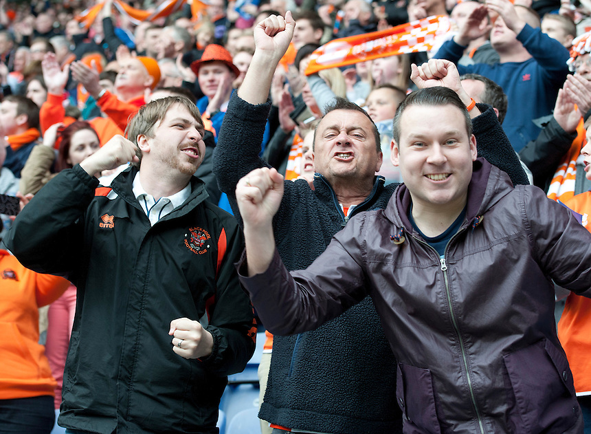 Blackpool fans celebrate their teams 2-0 victory at the final whistle<br /> <br /> Photo by Stephen White/CameraSport<br /> <br /> Football - The Football League Sky Bet Championship - Wigan Athletic v Blackpool - Saturday 26th April 2014 - DW stadium - Wigan<br /> <br /> &copy; CameraSport - 43 Linden Ave. Countesthorpe. Leicester. England. LE8 5PG - Tel: +44 (0) 116 277 4147 - admin@camerasport.com - www.camerasport.com
