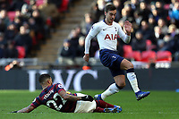 DeAndre Yedlin of Newcastle United and Harry Winks of Tottenham Hotspur during Tottenham Hotspur vs Newcastle United, Premier League Football at Wembley Stadium on 2nd February 2019