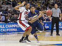 March 21st, 2013: California's Allen Crabbe drives into the paint and is being defended by UNLV's Anthony Bennett during a game at HP Pavilion, San Jose, California. California defeated UNLV 64 - 61