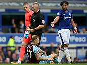 1st October 2017, Goodison Park, Liverpool, England; EPL Premier League Football, Everton versus Burnley; Scott Arfield of Burnley is shown a yellow card after being adjudged to have dived in the Everton penalty area