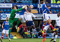 Adebayo Akinfenwa of Wycombe Wanderers with the challenge that lead to the first goal during the FA Cup 1st round match between Portsmouth and Wycombe Wanderers at Fratton Park, Portsmouth, England on the 5th November 2016. Photo by Liam McAvoy.