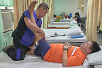 John Escovidal, a physical therapist, works on Litao Lindburg's leg in the Mary Johnston Hospital in Manila, Philippines. <br /> <br /> The hospital is supported by United Methodist Women.