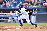 Asheville Tourists center fielder Shael Mendoza (21) swings at a pitch during a game against the Greensboro Grasshoppers at McCormick Field on May 11, 2018 in Asheville, North Carolina. The Tourists defeated the Grasshoppers 10-5. (Tony Farlow/Four Seam Images)