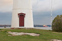 Close-up of Crossover Island Lighthouse's inviting door and a passing Great Lakes freighter in the 1000 Islands.