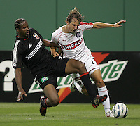 9 April 2005.  DC United defender David Stokes (2) tackles the ball away from Justin Mapp (21) of Chicago at RFK Stadium in Washington, DC.