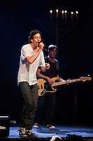 "Matisyahu performs during his ""Festival of Light"" tour with a menorah in the background at the Electric Factory in Philadelphia, December 12, 2012."