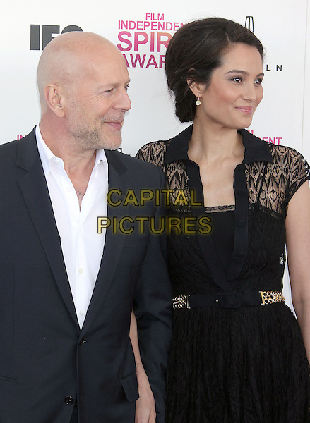 Bruce Willis, Emma Heming.2013 Film Independent Spirit Awards - Arrivals held at Santa Monica Beach..Santa Monica, California, USA,.23rd February 2013..indy indie indies indys half length black suit white shirt lace dress husband wife married shirt profile .CAP/ADM/RE.©Russ Elliot/AdMedia/Capital Pictures