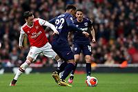 7th March 2020; Emirates Stadium, London, England; English Premier League Football, Arsenal versus West Ham United; Mesut Ozil of Arsenal challenges Sebastien Haller of West Ham United