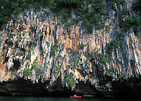 PaddleAsia group kayaking under karst formation of Ko Mok Island, Andaman Sea.