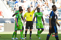 Referee Jorge Gonzalez sends of Seattle Sounders Lamar Neagle (27). The Philadelphia Union and the Seattle Sounders played to a 2-2 tie during a Major League Soccer (MLS) match at PPL Park in Chester, PA, on May 4, 2013.
