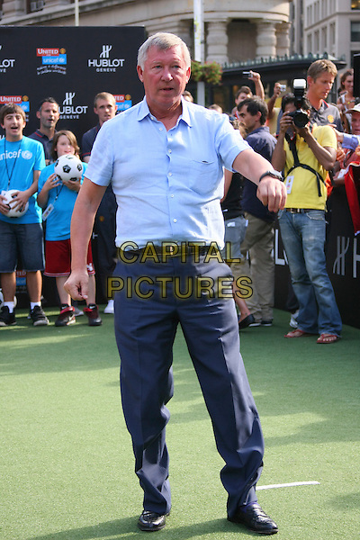 SIR ALEX FERGUSON .At the Hublot and Manchester United million dollar challenge photocall,  Madison Square Park in New York City, NY, USA, July 22nd 2010..full length man utd football fc manager boss   blue shirt navy trousers   .CAP/LNC/TOM.©LNC/Capital Pictures.