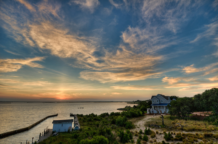 View of a sunset over the Currituck Sound from the west side of the Outer Banks of North Carolina
