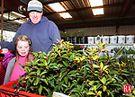 GOSHEN, CT-27 April 2007-042707MK01 Five year old Allison and her dad Gene Black look over their Mountain Laurels while waiting in line to check out at the Northwest Conservation District's 25th annual Earth Day Plant sale at the Goshen Fair Grounds.  The event which runs today from 9 a.m. to 4 p.m. and tomorrow from 9 a.m. to 3 p.m. is a major fund raiser for the Conservation District.  Purchases provide funding for local conservation projects and education in addition to helping to curb climate change by planting items that absorb greenhouse gas pollution.   Michael Kabelka / Republican-American(Five year old Allison and her dad Gene Black) CQ