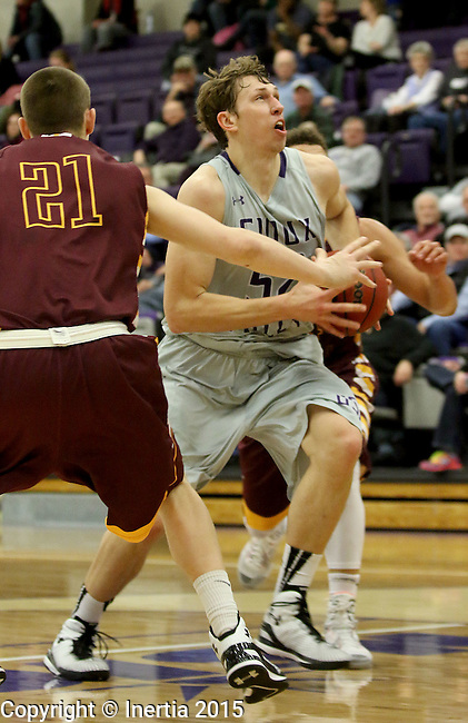 SIOUX FALLS, SD - JANUARY 30:  Bryan Kielpinski #52 from the University of Sioux Falls drives to the basket past Kyle Schalow #21 from Minnesota Duluth in the first half of their game Friday night at the Stewart Center.  (Photo by Dave Eggen/Inertia)
