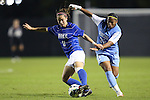 18 October 2012: Duke's Cassie Pecht (11) and UNC's Meg Morris (32). The University of North Carolina Tar Heels defeated the Duke University Blue Devils 2-0 at Koskinen Stadium in Durham, North Carolina in a 2012 NCAA Division I Women's Soccer game.