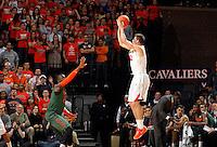 Virginia guard Joe Harris (12) shoots over Miami guard Garrius Adams (25) during an NCAA basketball game Saturday Feb, 24, 2014 in Charlottesville, VA. Virginia defeated Miami 65-40.