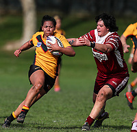 Louisa Gago of Manurewa looks to avoid the tackle of Natalia Tahana of Papakura. Premier Women's Rugby League, Papakura Sisters v Manurewa Wahine, Prince Edward Park, Auckland, Sunday 13th August 2017. Photo: Simon Watts / www.phototek.nz
