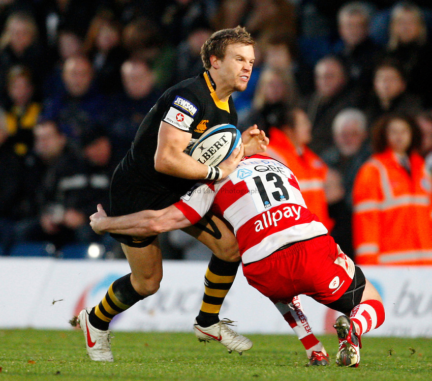Photo: Richard Lane/Richard Lane Photography. London Wasps v Gloucester Rugby. LV= Cup. 15/11/2009. Wasps' Lachlan Mitchell is tackled by Gloucester's Henry Trinder.
