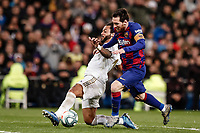 1st March 2020; Estadio Santiago Bernabeu, Madrid, Spain; La Liga Football, Real Madrid versus Club de Futbol Barcelona; Lionel Messi (FC Barcelona) and Marcelo of Real chase the loose ball as Marcelo pokes the ball away