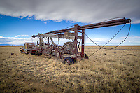 An old drilling rig left sitting in a pasture in New Mexico.