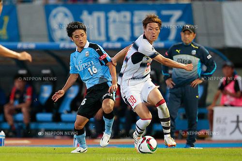(L to R) <br /> Ryota Oshima (Frontale), <br /> Keigo Higashi (FC Tokyo), <br /> JULY 11, 2015 - Football / Soccer : <br /> 2015 J1 League 2nd stage match <br /> between Kawasaki Frontale 2-0 F.C. Tokyo <br /> at Kawasaki Todoroki Stadium, Kanagawa, Japan. <br /> (Photo by AFLO SPORT)