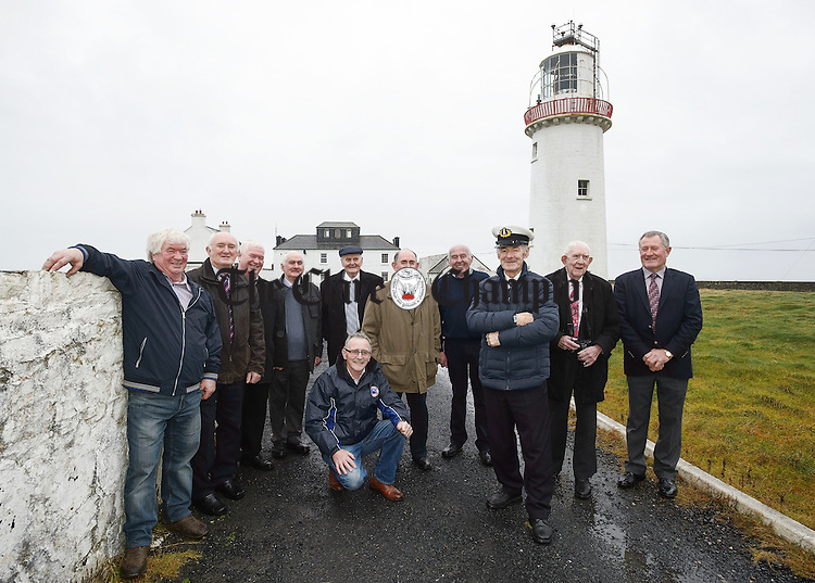 A group of light house keepers and attendants who returned to Loop Head Light House to mark the retirement of Tom Mc Inerney after 19 years service. from left;  Gerry Tevlin (24 years), Sean Heston (17 years), Mick Tevlin (24 years), Vincents Moran (19 years), Jim Tweedy (39 years), John P Magner (24 years), Kevin Magner (21 years), Vincent Hedderman (24 years), Tom McInerney (19 years), John Fitzgerald (kneeling down, 12 years). Photograph by John Kelly/John Kelly Photography by John Kelly.