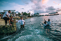Members of the Mormon Church baptise 16 year old Linty Lang in the waters of the Pacific Ocean. Ebeye became a magnet for missionaries from many religious groups and churches for whom Ebeye is a convenient place to set up base and is itself populated by more than 13 thousand poor and socially deprived ideal potential recruits.