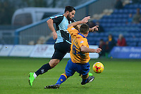 Wycombe Wanderers Sam Wood skips past the challenge of Mansfield Town's Lee Collins during the Sky Bet League 2 match between Mansfield Town and Wycombe Wanderers at the One Call Stadium, Mansfield, England on 31 October 2015. Photo by Garry Griffiths.